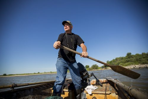 Charlie MacPherson pushes off towards the Netley-Libau March on Lake Winnipeg on Wednesday, July 22, 2015.  Because of continuous high water levels, the marsh ecosystem is suffering in many ways. Mikaela MacKenzie / Winnipeg Free Press