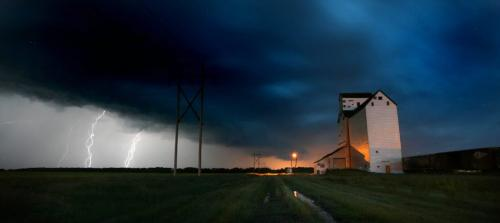 PHIL HOSSACK / WINNIPEG FREE PRESS 070619 LIGHTNING ILLUMINATES AN ABANDONED GRAIN ELEVATOR IN THE VILLAGE OF SANFORD ABOUT 10PM TUESDAY NIGHT AS A LINE OF THUNDERSTORMS PASSED NEAR WINNIPEG JUST TO THE NORTH OF THIS  SITE.