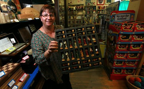 Toad Hall Toys owner KARI ENGLAND poses in her store for a story on how the declining value of the Canadian dollar is driving up the price of some of the toys in her Exchange District store. See Murray McNeill's story. September 22,2015 - (PHIL HOSSACK / WINNIPEG FREE PRESS)