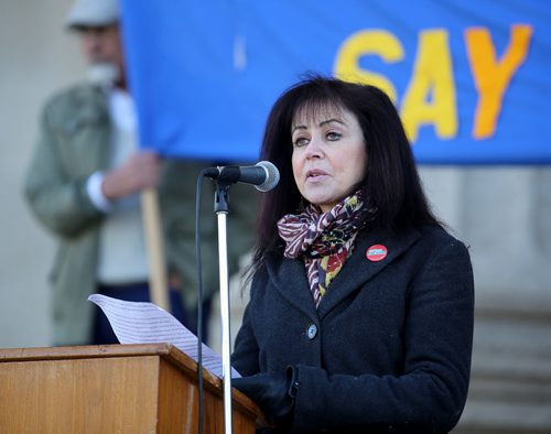 Belle Jarnewski speaks to more than 200 anti-racism and anti-Islamaphobia protestors gathered outside the Manitoba Legislative Building, Saturday, October 17, 2015. (TREVOR HAGAN/WINNIPEG FREE PRESS)