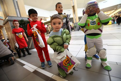 Kids dressed up in costumes eagerly wait in line for goodies at Kildonan Place Mall Friday afternoon for their annual Trick or treating at the mall event.   Standup photo Oct 29, 2015 Ruth Bonneville / Winnipeg Free Press