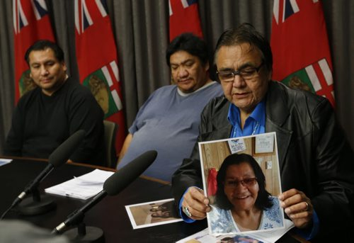 Manitoba's Aboriginal Affairs Minister Eric Robinson is calling for an inquiry Friday into the case of two northern babies switched at birth. He is holding a photo of Rebecca Barkman, the birth mother of Luke Monias seated in the middle beside  Norman Barkman at news conference. Mary Agnes Welch  story   Wayne Glowacki / Winnipeg Free Press Nov. 13   2015