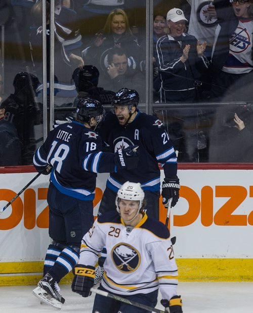Winnipeg Jets' Blake Wheeler (26) celebrates his goal with Bryan Little (18) after tipping the puck past Buffalo Sabres' goaltender Linus Ullmark (35) during first period NHL action in Winnipeg on Sunday, January 10, 2016. 160110 - Sunday, January 10, 2016 -  MIKE DEAL / WINNIPEG FREE PRESS
