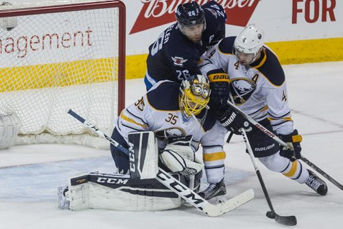 Winnipeg Jets' Blake Wheeler (26) tries to get the rebound but is squeezed out by Buffalo Sabres' Josh Gorges (4) and goaltender Linus Ullmark (35) during third period NHL action in Winnipeg on Sunday, January 10, 2016. 160110 - Sunday, January 10, 2016 -  MIKE DEAL / WINNIPEG FREE PRESS