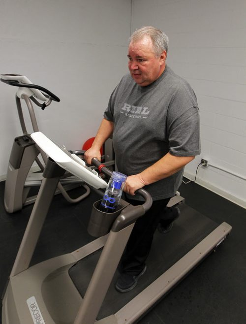 President of the Manitoba Metis Federation David Chartrand recently suffered a mini stroke in Paris, France. Gord Sinclair is doing a story on his new outlook on life. He has a treadmill in the office he works out on. BORIS MINKEVICH / WINNIPEG FREE PRESS February 9, 2016