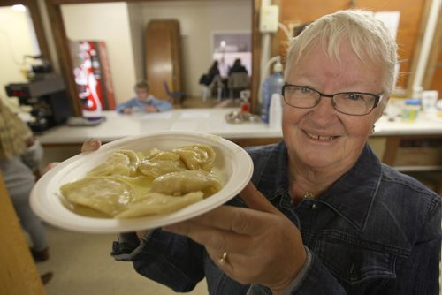 JOE BRYKSA / WINNIPEG FREE PRESSFoxwarren, Manitoba, Foxwarren Recreation rink-,Volunteer Bev Wotton shows home made perogies- a fan favorite for sale in cafeteria, February 16, 2016.( See Randy Turner rural hockey rinks 49.8 story)