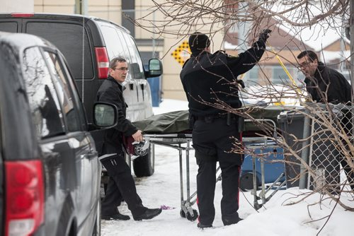 MIKE DEAL / WINNIPEG FREE PRESS Winnipeg Police Service investigate at a house on Pritchard Avenue where a body was removed from the home shortly after 2 p.m. 160222 - Monday, February 22, 2016