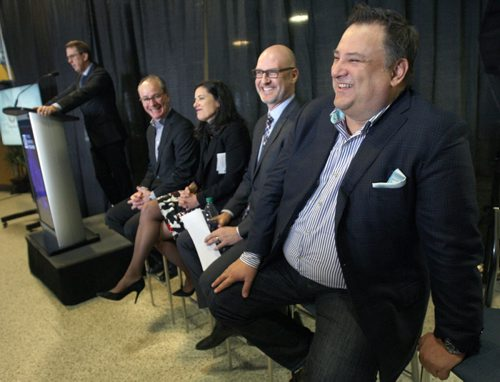 JOE BRYKSA / WINNIPEG FREE PRESS  Tom Gaglardi,, right, Chairman and CEO of the Sutton Place Hotels  laughs as Mark Chipman- Chairman True North Sports and Entertainment introduces him at True North Square news conference in MTS Centre, February 24, 2016.( See Murray McNeil story)