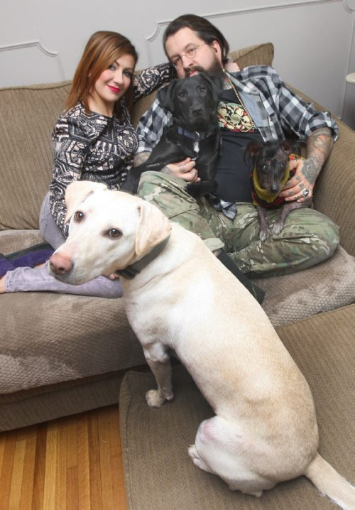 JOE BRYKSA / WINNIPEG FREE PRESS  Eric Johanson and his wife Rachel with their dogs,  Lulu who was rescued from North Of Norway House,front, Tito who was rescued from  the former Yugoslavia, centre, and Kuxuum who was rescued from Mexico , March 04, 2016.(See  Gordon Sinclair column)