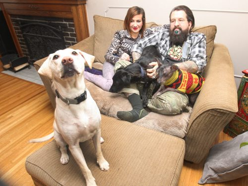 JOE BRYKSA / WINNIPEG FREE PRESS  Eric Johanson and his wife Rachel with their dogs L to R,  Lulu who was rescued from North Of Norway House, Tito who was rescued from  the former Yugoslavia and Kuxuum who was rescued from Mexico , March 04, 2016.(See  Gordon Sinclair column)