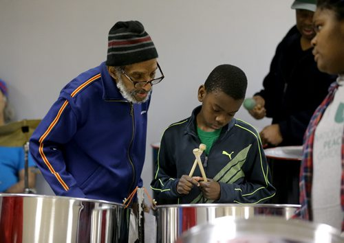 TREVOR HAGAN / WINNIPEG FREE PRESS Gerry Sampson instructs Donnie Martin, 11, both are members of Hi-Life Steel Orchestra, practicing at the Caribbean Community Cultural Centre, Saturday, March 19, 2016. For Brenda Suderman Faith page March 26