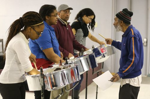 TREVOR HAGAN / WINNIPEG FREE PRESS From left, Renisha Pivott, Olexa Blackwood, Ali Karim and Janelle King, all receiving instructions from Gerry Sampson, all members of Hi-Life Steel Orchestra, practicing at the Caribbean Community Cultural Centre, Saturday, March 19, 2016. For Brenda Suderman Faith page March 26