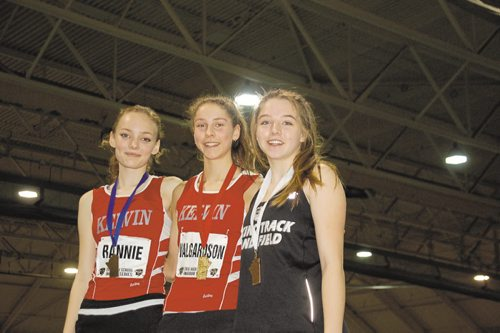 Canstar Community News Erin Valgardson of Kelvin High School (centre) won the junior women's 1,500 metres in a time of 5:15.2 at the 2016 High School Series provincial indoor athletics championship on March 17. Emma Rannie of Kelvin (left) was second, while Drew Curtis of Brandon's Vincent Massey High School (right) finished third.