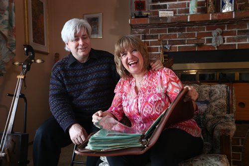 RUTH BONNEVILLE / WINNIPEG FREE PRESS  Crystal and her husband Mark Kolt, look over a large binder in their home of historical photos from Flin Flon's rich history of arts.   Crystal is Head of the Flin Flon Arts Council and her husband Mark is very involved in musical productions in the city.    Feature story on the vibrant arts community in Flin Flon Manitoba by reporter, Erin Lebar.    March 19, 2016