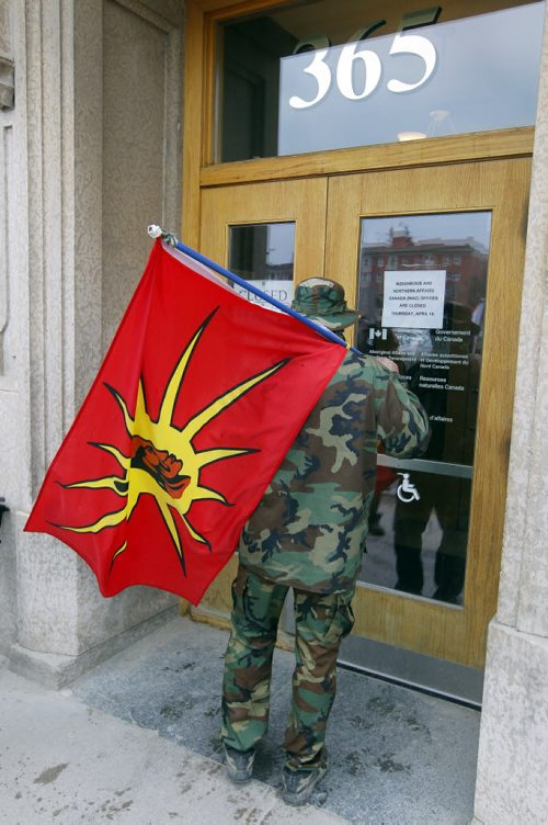 BORIS MINKEVICH / WINNIPEG FREE PRESS Protesters have been peacefully occupying the Winnipeg office of Indigenous and Northern Affairs Canada (INAC) at 365 Hargrave Street for the past 24 hours. Occupiers will release a statement in video and text form this morning at 11:00 am. Indigenous protesters and allies, who joined the #OccupyINAC campaign originally begun in Toronto on Wednesday, in response to the suicide epidemic in Attiwapiskat and Pimicikamak. Photo taken outside building. April 15, 2016