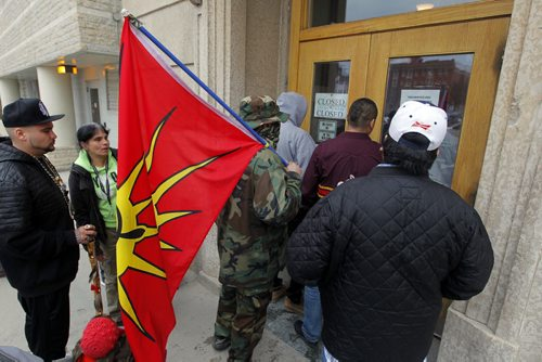BORIS MINKEVICH / WINNIPEG FREE PRESS Protesters have been peacefully occupying the Winnipeg office of Indigenous and Northern Affairs Canada (INAC) at 365 Hargrave Street for the past 24 hours. Occupiers will release a statement in video and text form this morning at 11:00 am. Indigenous protesters and allies, who joined the #OccupyINAC campaign originally begun in Toronto on Wednesday, in response to the suicide epidemic in Attiwaspikat and Pimicikamak. Photo taken outside building. April 15, 2016
