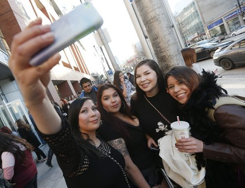 JOHN WOODS / WINNIPEG FREE PRESS Rihanna fans Monica (from left), Abigail, Savannah and Melahat pose for a photo before heading into the show  Monday, April 18, 2016.