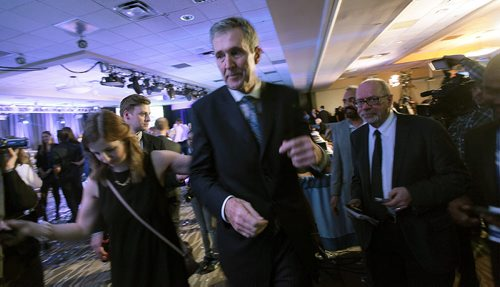 "PHIL HOSSACK / WINNIPEG FREE PRESS Premier elect now, Brian Pallister makes the rounds of media interviews post PC ""party"". Media aid Olivia Billson (left) directs.  See story. April 19, 2016"