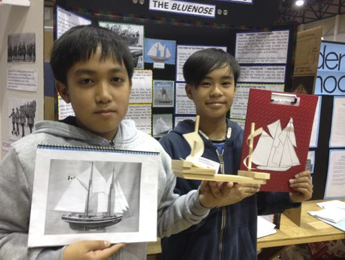 Jezerie-Norejl Domingo, 11, a Grade 6 student at Red River Valley, and Adrian Dela Pena, an 11-year-old Grade 5 student, know everything there is to know about the Bluenose. Doug Speirs photo, Winnipeg Free Press