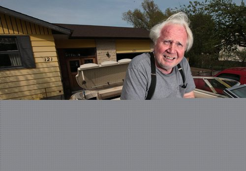 PHIL HOSSACK / WINNIPEG FREE PRESS - Willi Jantz, poses in a ski boat he and his son have refurbished. For a 49/8 feature on East and West St. Paul. Jantz moved here in 1971 when the smell from the oil refinery was so bad you could buy a house on an acre of land for $1,500, as he did. The refinery closed in few years later, and values shot up. Just the empty lots in town now sell for $250,000. Sill Redekopp's feature. May 18, 2016