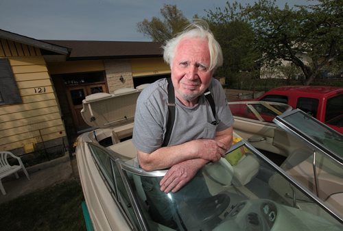 PHIL HOSSACK / WINNIPEG FREE PRESS - Willi Jantz, poses in a ski boat he and his sone have refurbished. For a 49/8 feature on East and West St. Paul. Jantz moved here in 1971 when the smell from the oil refinery was so bad you could buy a house on an acre of land for $1,500, as he did. The refinery closed in few years later, and values shot up. Just the empty lots in town now sell for $250,000. Sill Redekopp's feature. May 18, 2016