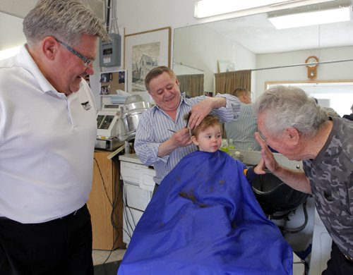 BORIS MINKEVICH / WINNIPEG FREE PRESS (centre) Barber Rocky Curatola of Rocky's Men's Hair Styling cuts a fifth generation customer Lincoln Alto, just shy of 2 years old, while grandpa (left) Dr. Lauri Alto, 61, and great grandpa (right) Olie Alto, 87, watch on. This is the boys 3rd haircut. The boys dad couldn't make it down for the photo because of work, but grandpa and great gramps were happy to help pass down the family tradition. Photo taken at the barber shop's current location at 290 Pembina Highway. May 19, 2016.
