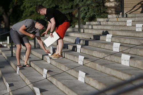 JOHN WOODS / WINNIPEG FREE PRESS Names of Orlando shooting victims are places prior to a vigil for Orlando shooting victims at the Manitoba Legislature Monday, June 13, 2016.