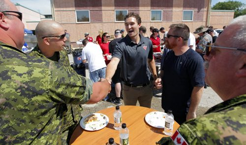 BORIS MINKEVICH / WINNIPEG FREE PRESS Mark Stone, Winnipeg Native and NHL Hockey Player, Ottawa Senators, talks to some military personal from 17 Wing. (in camp L-R) Cpl. Patrick Portelance, Cpl Sebastien Parent, Mcpl. Jason Fortin and Mcpl. John D'Eon. FROM PRESS RELEASE - NHL Hockey Players Join for Community Celebration at 17 Wing Winnipeg   WINNIPEG, MB –As part of a $300,000 commitment, Canadian Tire has embarked on a military base tour in support of Canadian Armed Forces Recreation Month, including a stop at 17 Wing Winnipeg.  The three-year commitment with Canadian Forces Morale and Welfare Services includes $300,000 in gift card and sporting equipment donations across every military base in Canada, to help military families living on base get active. To celebrate the ongoing commitment, Canadian Tire will participate in six military base events including: 17 Wing Winnipeg, Greenwood, NS, Gagetown, NB, Valcartier, QC, Ottawa, ON and Kingston, ON.   Canadian Tire will join the men, women and families living at 17 Wing Winnipeg on Friday, June 24 for a formal presentation followed by an athlete autograph session. June 24, 2016.