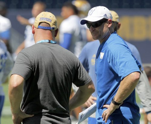 BORIS MINKEVICH / WINNIPEG FREE PRESS Winnipeg Blue Bombers practice at Investors Group Field in Winnipeg, MB.Right is Coach Paul LaPolice and right is Head Coach Mike O'Shea. July 4, 2016