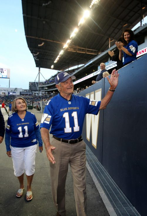 RUTH BONNEVILLE / WINNIPEG FREE PRESS  All-star quarterback Ken Ploen who started with The Winnipeg Blue Bombers in 1957,  shakes fans hands as he walks out of the stadium with his wife, Janet,  after he was inducted into the Ring of Honour during halftime  of Bombers hosting Eskimos game at Investors Group Stadium Thursday night.    July 14, 2016