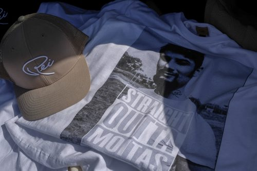 ZACHARY PRONG / WINNIPEG FREE PRESS  Pedro Reis has been selling hats and t-shirts adorned with his father's signature and photos out of the back of his trunk. He plans on expanding his business in the near future. July 20, 2016.