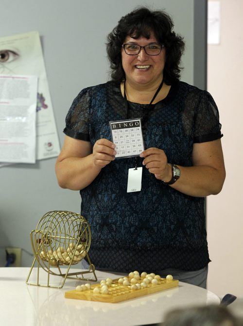 BORIS MINKEVICH / WINNIPEG FREE PRESS VOLUNTEER COLUMN- Shelley Malo volunteers every Thursday evening at Main Street Project. She leads Main Street Project clients in playing recreational bingo. July 21, 2016