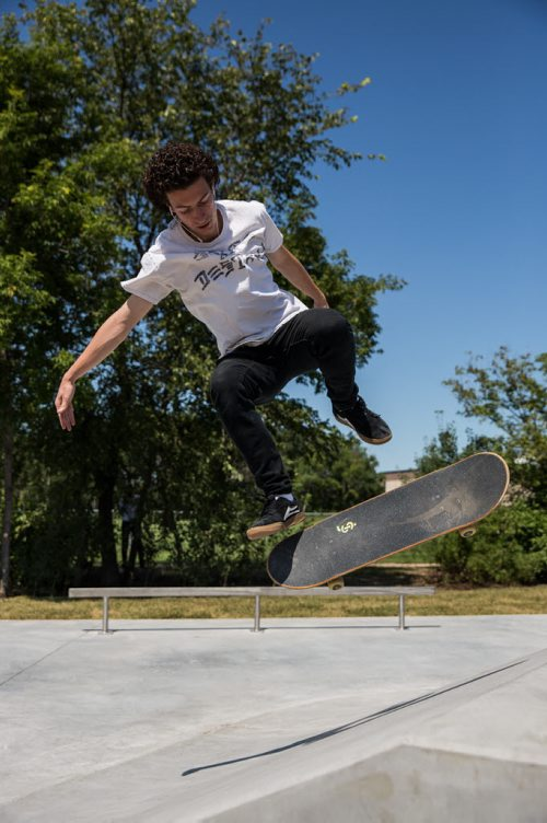 MIKE DEAL / WINNIPEG FREE PRESS The Justin Einarson Memorial Skatepark in Fort Richmond was dedicated by community members, officials from the City of Winnipeg and the Province Sunday afternoon.  Danny Taylor tries out some moves on the newly dedicated skatepark. 160807 - Sunday, August 07, 2016