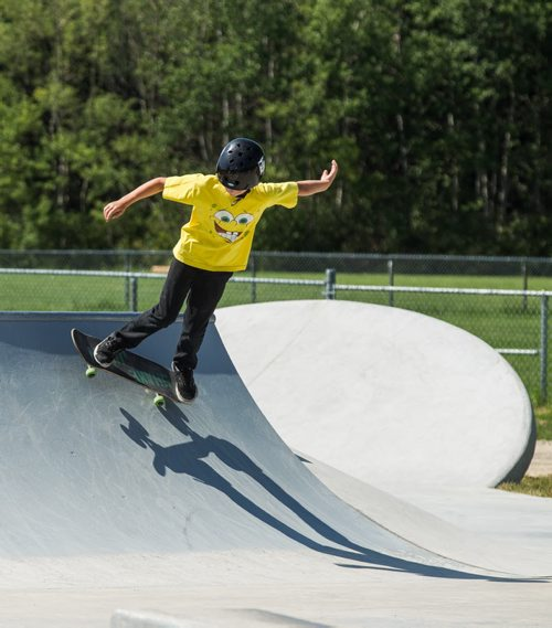 MIKE DEAL / WINNIPEG FREE PRESS The Justin Einarson Memorial Skatepark in Fort Richmond was dedicated by community members, officials from the City of Winnipeg and the Province Sunday afternoon.  Nolan Webster, 11, tries out some moves on the newly dedicated skatepark. 160807 - Sunday, August 07, 2016