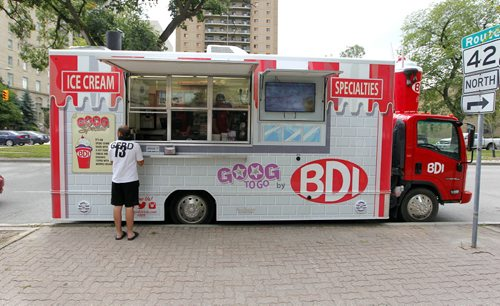BORIS MINKEVICH / WINNIPEG FREE PRESS A general photo of the all new BDI mobile truck was on Broadway Ave. near Garry Street. Photo taken over the lunch hour. The new mobile BDI truck hit the streets less than a week ago. The owner of the truck says lineups are just as long as the original BDI so far. The person standing at the truck agreed to let us use the photo but didn't want to have his name used. August 19, 2016