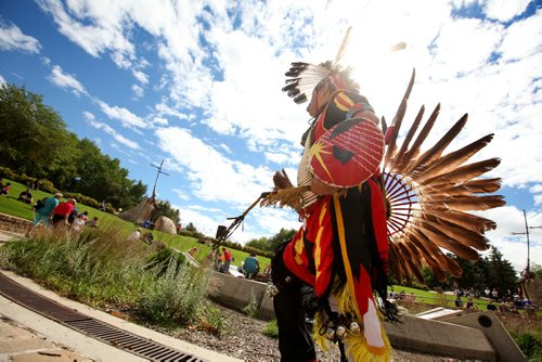 RUTH BONNEVILLE  / WINNIPEG FREE PRESS  Men's Tradional dancer, Ken Saunders makes his way around the Oodena Celebration Circle.at the Forks along with other dancers with the Founding Nations of Manitoba during a Pow Wow Saturday. Standup photo  Aug 19 / 2016