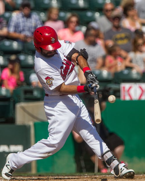 MIKE DEAL / WINNIPEG FREE PRESS Winnipeg Goldeyes Willie Cabrera hits the ball for a single base hit during the game against the Sioux City Explorers Sunday afternoon.  20160828 - Sunday August 28, 2016
