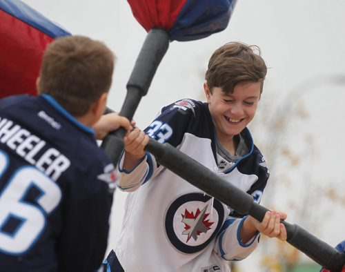 RUTH BONNEVILLE / WINNIPEG FREE PRESS  Twelve-year-old Michael Goncalves plays the gladiator game against his younger brother Daniel (9yrs) at the Jets FanFest at IcePlex Saturday.    September 24, 2016