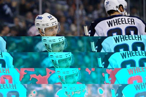 JOHN WOODS / WINNIPEG FREE PRESS Winnipeg Jets' Mark Scheifele (55) and Blake Wheeler (26) celebrate Scheifele's goal against the Ottawa Senators during second period pre-season NHL action in Winnipeg on Monday, October 3, 2016.