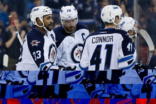 JOHN WOODS / WINNIPEG FREE PRESS Winnipeg Jets' Dustin Byfuglien (33), Blake Wheeler (26) and Kyle Connor (41) celebrate Wheeler's goal against the Ottawa Senators during second period pre-season NHL action in Winnipeg on Monday, October 3, 2016.