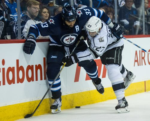 MIKE DEAL / WINNIPEG FREE PRESS Winnipeg Jets' Dustin Byfuglien (33) and Los Angeles Kings' Alec Martinez (27) during an afternoon NHL game at MTS Centre Sunday. 161113 - Sunday November 13, 2016
