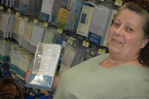 "Shelley Seidl, a shopper at a Winnipeg Walmart, shown holding a PVC shower curtain. A report released today by the U.S.-based Centre for Health, Environment and Justice said PVC curtains such as those shown here may be releasing toxic compounds into people's homes. ""I'll have to try something else,"" Seidl said. June 12, 2008. By Will Tremain Winnipeg Free Press"