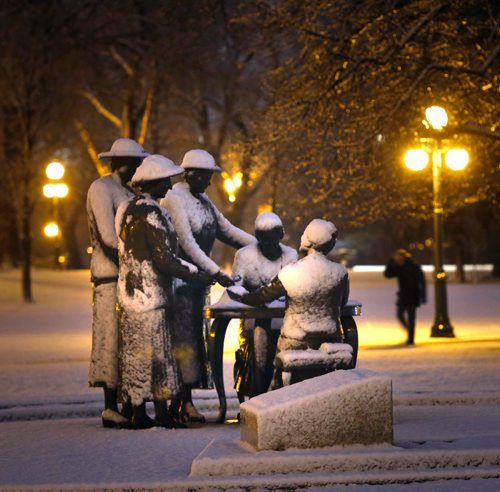 WAYNE GLOWACKI / WINNIPEG FREE PRESS The overnight snow fall Tuesday morning covers the bronze Nellie McClung Memorial on the Manitoba Legislative building grounds and has created slippery driving conditions outside the city.  November 29 2016