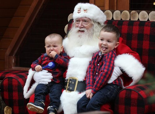 RUTH BONNEVILLE / WINNIPEG FREE PRESS      Brothers Ethan (11months) and Mason (3yrs) Bauske have completely different emotions as they have their photo taken with Santa at Polo Park's Santa display Wednesday. It wasn't long before Mason cheered up after he was back in mom's arms and got his candy cane.  Standup   Nov 30, 2016