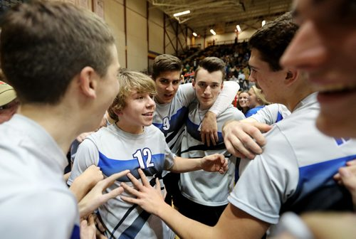 TREVOR HAGAN / WINNIPEG FREE PRESS The Lord Selkirk Royals celebrate after defeating the Miles Macdonell Buckeyes in the provincial volleyball championship, Monday, December 5, 2016.