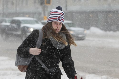 RUTH BONNEVILLE / WINNIPEG FREE PRESS  A young women makes her way across Colony Street at Portage Ave. dung blowing snow and pure visibility Tuesday.   Weather Standup Dec 6, 2016
