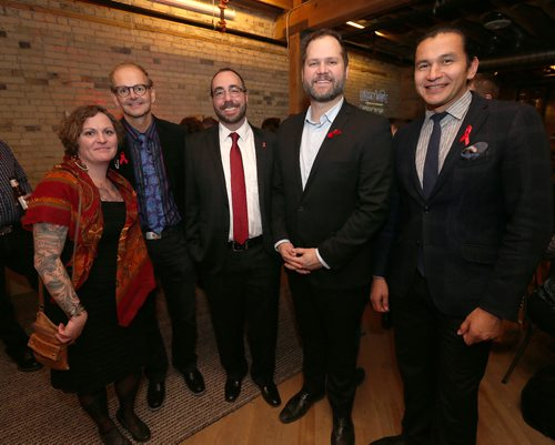JASON HALSTEAD / WINNIPEG FREE PRESS  L-R: Stephanie Van Haute (Nine Circles program development officer), Dr. Ken Kasper (director of the Manitoba HIV program), Mike Payne (Nine Circles executive director), Matt Wiebe (MLA for Concordia) and Wab Kinew (MLA for Fort Rouge) at Nine Circles Community Health Centre's World AIDS Day Crimson & Cocktails mixer on Dec. 1, 2016, at Forth in the Exchange District. (See Social Page)