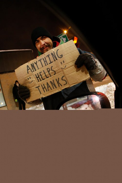 JOHN WOODS / WINNIPEG FREE PRESS Cam thanks passersby for any little help they can give at Maryland and Broadway Tuesday, December 13, 2016. The city is abuzz with new found concern for people living on the street after a woman died on the street yesterday