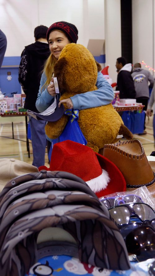 WAYNE GLOWACKI / WINNIPEG FREE PRESS  Raelynn Beaton, a grade 9 student, looks for gifts for her family at the pop-up set up in the R. B. Russell Vocational High School Thursday. The store is put on by Think Shift, a local marketing company, which donates everything for the event to give less fortunate kids a chance to shop, for free, for Christmas gifts for their families. Ashley Prest story.  Dec.15 2016