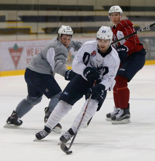WAYNE GLOWACKI / WINNIPEG FREE PRESS   In centre is left winger, Brandon Tanev #26 with Scott Kosmachuk # 24 at left and Jan Kostalek #3 at the Manitoba Moose practice Wednesday in the MTS IcePlex. Mike McIntyre story.  Dec.28 2016
